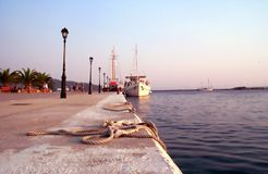 At the docks. Ship at sunset (rope in focus). Northern Greece Stock Image