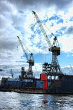 Cranes in Hamburg port. Under clouds Royalty Free Stock Photo