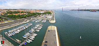 Docks on the banks of River Tagus in Lisbon, Portugal Royalty Free Stock Photo