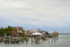 Docks on a Bay in Florida. Florida Lifestyle. The docks on a bay in Florida of those fortunate enough to live there Stock Images