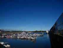 Docks. Blue sky boat pier bridge lake water royalty free stock photography