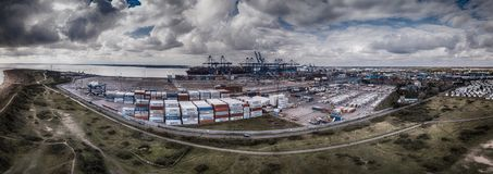 Docks and Containers. A wonderful panoramic view of Felixstowe docks loading ships and moving containers and goods stock photography