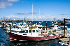 Docks and fishing boats on MacMillan Pier, Provincetown, MA. Royalty Free Stock Photos