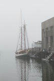 Docks on a foggy morning Royalty Free Stock Photography