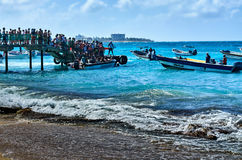 The docks of Johnny Cay. JOHNNY CAY, COLOMBIA - JANUARY 09, 2015: People boarding the ships to return to San Andres from Johnny Cay Royalty Free Stock Images