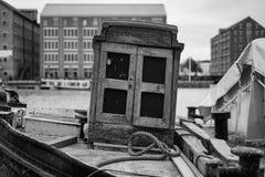 At the docks. Docks oat boar boat window wood old stock photo