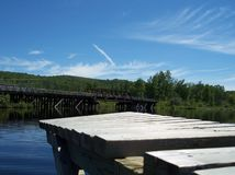 Docks and a Rail Bridge. An old rail bridge and a low angle shot of a dock. This photo was taken in Algonquin Provintial Park in Ontario, Canada stock images
