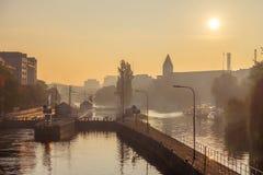 Docks on river Spree in morning mist, Berlin, Germany Royalty Free Stock Image