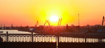 Docks at sunset. Docks cranes in the river port at sunset Stock Image