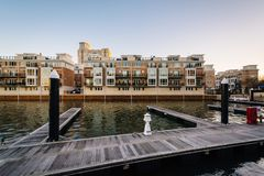 Docks and waterfront residences at the Inner Harbor in Baltimore, Maryland.  royalty free stock photos