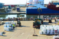 Dockside activity. Forklift trucks at work Stock Image