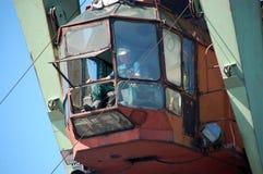 Dockside cargo crane operator at river port Kolyma Stock Photography