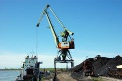 Dockside cargo crane at river port Kolyma Royalty Free Stock Photos
