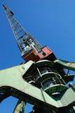 Dockside cargo crane at river port Kolyma Stock Photos