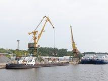 Dockside crane barge ship rubble Stock Images
