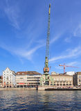 Zurich cityscape with a dockside crane Royalty Free Stock Photography