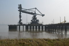 Dockside cranes along Tilbury in Essex. Heavy dockside equipment along the River Thames at Tilbury, Essex stock photo