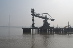 Dockside cranes along Tilbury in Essex. Heavy dockside equipment along the River Thames at Tilbury, Essex Stock Images