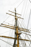 Dockside of old sailing ship Stock Images