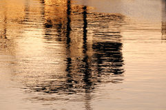 Dockside reflections at sunset Royalty Free Stock Photography