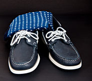 Docksides deck shoes with hand-linked toes socks. Blue Docksides deck shoes with hand-linked toes socks isolated on black Royalty Free Stock Images