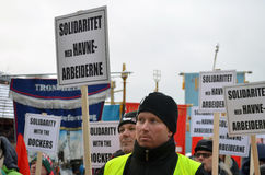 Dockworkers protest at Port of Oslo. Norwegian dockers and trade unionists protest the new owner of the port of Oslo 05.02.2015, after the Turkish company Royalty Free Stock Photos