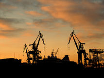 Dockyard with 2 Cranes. In Sunset Royalty Free Stock Photos