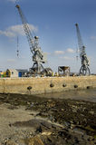 Dockyard cranes on a jetty. Guernsey Stock Photos