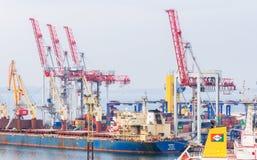 Dockyard cranes load heavy bulk carrier Royalty Free Stock Photos