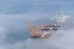 Dockyard cranes in the mist Royalty Free Stock Photo
