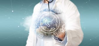 Docotor holding a World globe surronding by ecology icons and connection 3d rendering. View of a Docotor holding a World globe surronding by ecology icons and royalty free stock image
