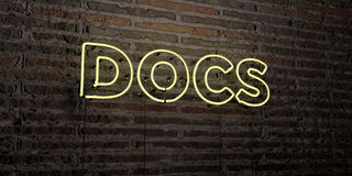 DOCS -Realistic Neon Sign on Brick Wall background - 3D rendered royalty free stock image. Can be used for online banner ads and direct mailers Royalty Free Stock Photo