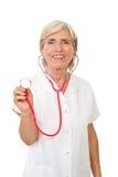 Docteur aîné gai avec le stéthoscope Image libre de droits
