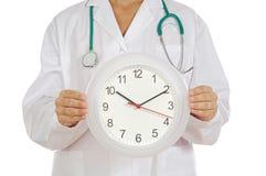Docteur affichant l'horloge Photos stock