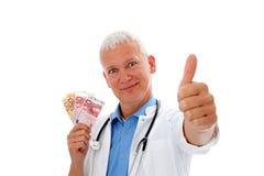 Docteur avec de l'argent et le coup vers le haut images libres de droits