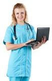 Docteur avec l'ordinateur portatif photo stock