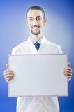 Docteur avec le panneau blanc Photographie stock