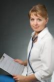 Docteur avec le stéthoscope et l'électrocardiogramme Photos libres de droits
