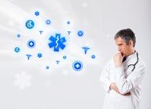 Docteur avec les icônes médicales bleues image stock
