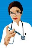 Docteur avec une seringue photos stock