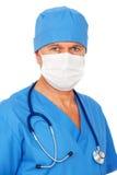 Docteur dans le masque et l'uniforme bleu Image stock