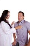 Docteur de femme avec le patient mâle Images libres de droits