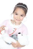 Docteur de petite fille avec l'ours de nounours Photo stock