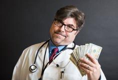 Docteur Displaying Cash ! image stock