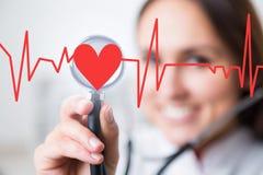 Docteur et coeur Photo libre de droits