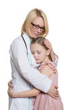 Docteur et une patiente de sourire de fille d'isolement en fonction Image libre de droits