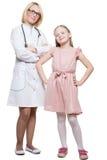 Docteur et une patiente de sourire de fille d'isolement en fonction Image stock
