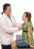 Docteur Examining Young Patient Photographie stock