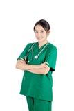 Docteur féminin asiatique de sourire avec le stéthoscope d'isolement sur b blanc Image stock