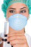 Docteur féminin avec la robe de recherche d'exécution Photographie stock